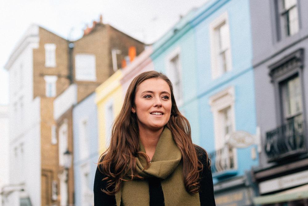 A woman stands on Portobello road, London