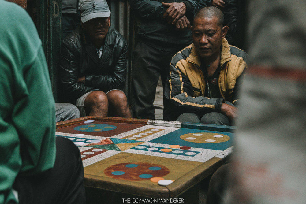 Annapurna Circuit trekking tips - locals play games on the Annapurna circuit