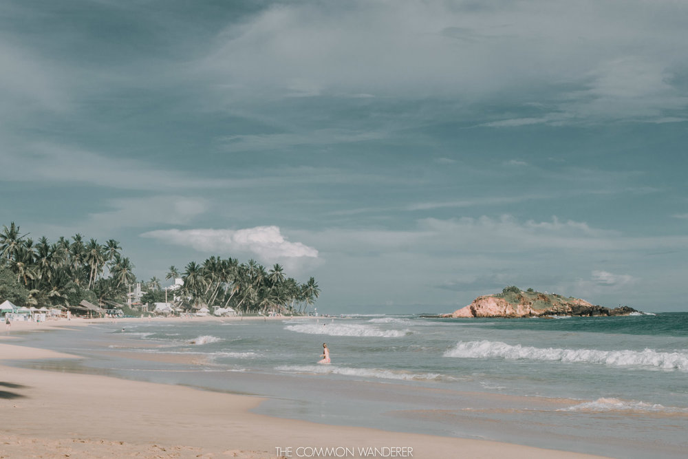 woman-swimming-at-mirissa-beach-sri-lanka