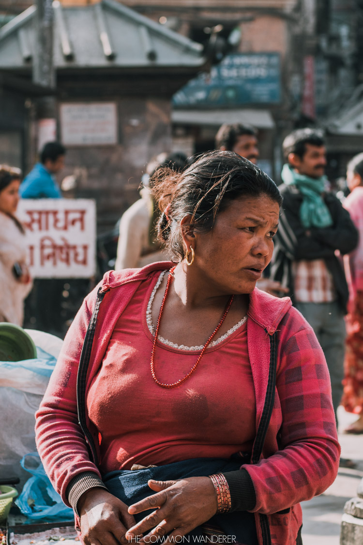 Fears about Nepal - lady sits at boudhanath stupa