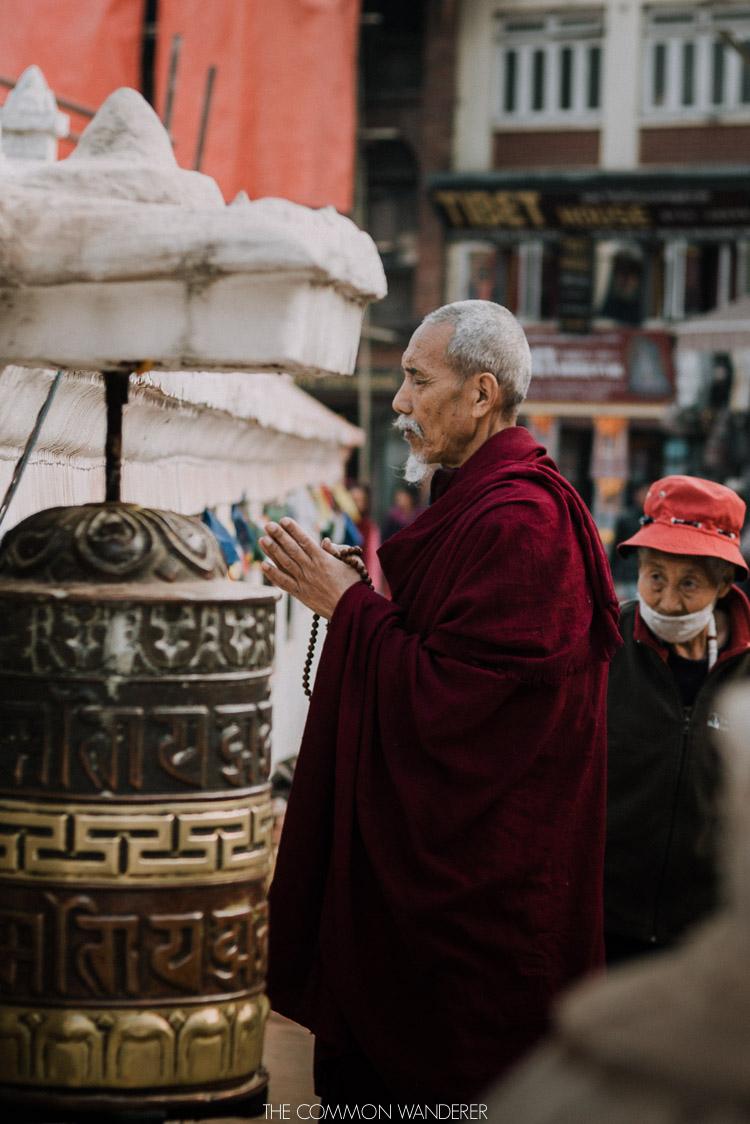 A monk prays at Boudhanath Stupa in Kathmandu, Nepal