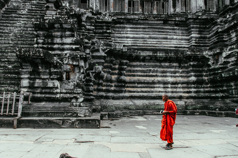 Cambodia photo diary a monk walks through angkor wat