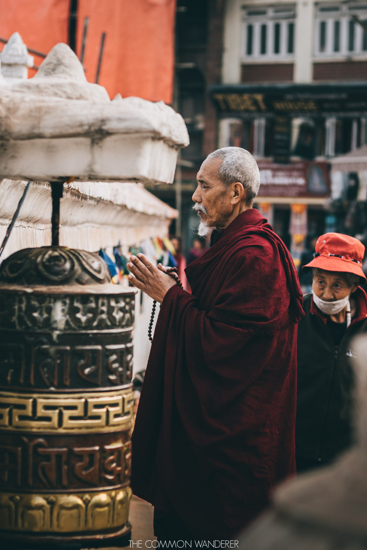 praying at Boudhanath Stupa - 30 photos that will make you want to visit Nepal