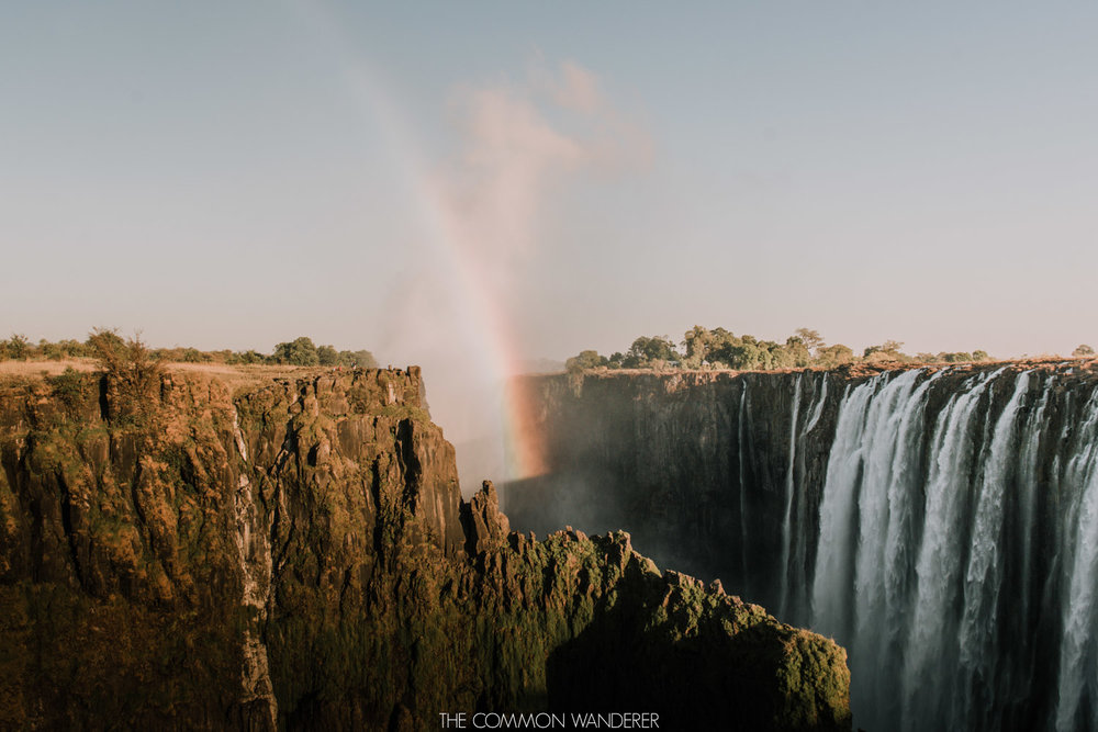 A rainbow over Victoria Falls, Zambia - The Common Wanderer