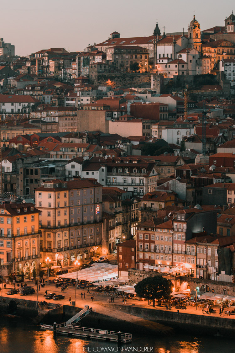 The ribeira district of porto and the Douro lit up at twilight