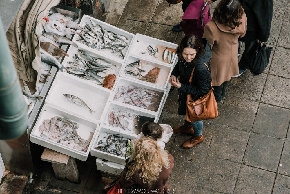 customers line up to purchase fresh seafod in Mercado do Bolhao market, Porto