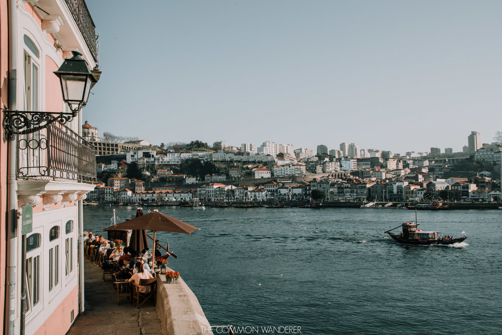 A view of boats on the Douro river and Porto's Ribeira district