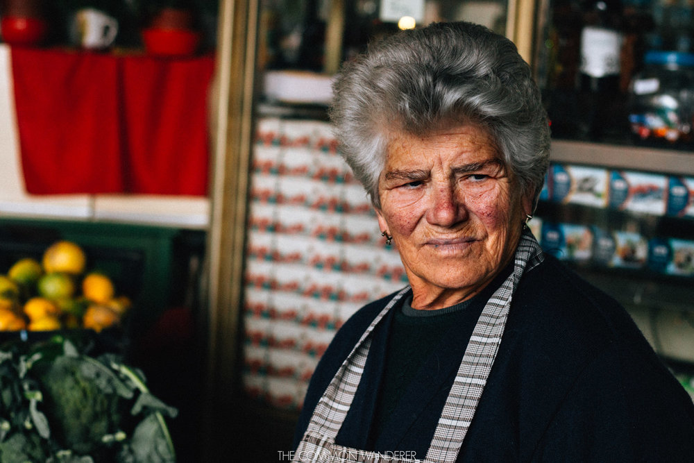 a lady smiles at her customers in the Mercado do Bolhao in Porto