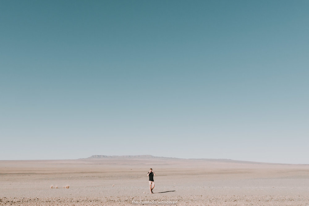 A man walks through the barren plains of Namibia - Namibia photos