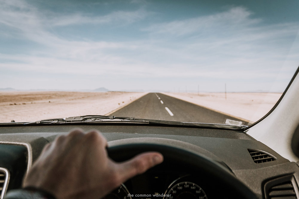 Driving along a long, straight road in Namibia - Namibia photos