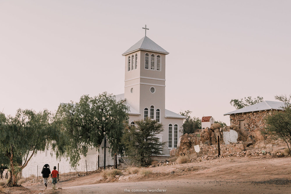 Children walk past Aus church, Aus, Namibia