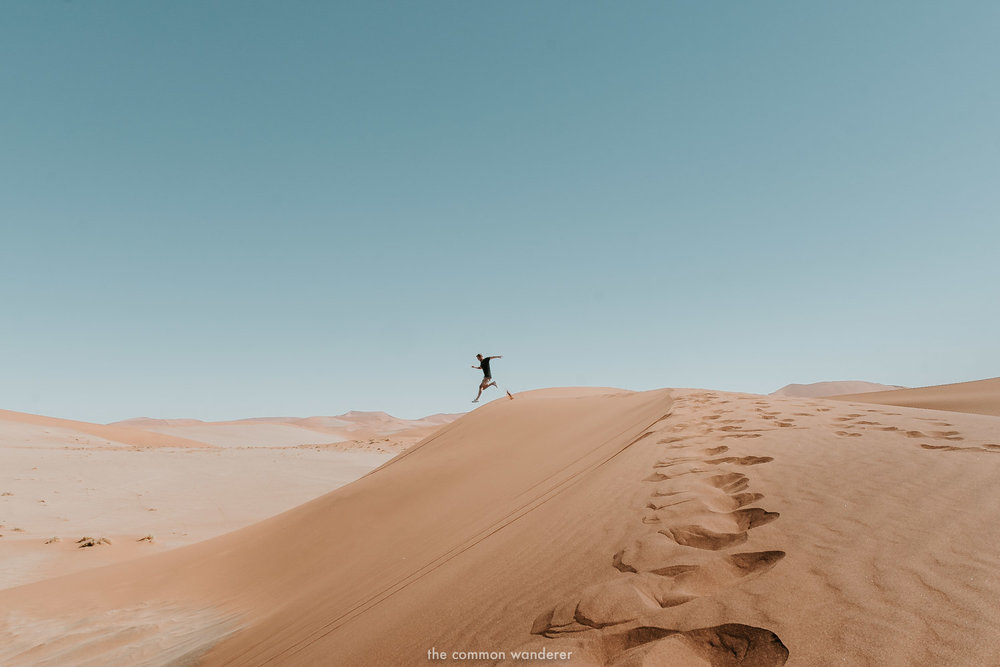 A man jumps off a dune in Sossusvlei, Namibia