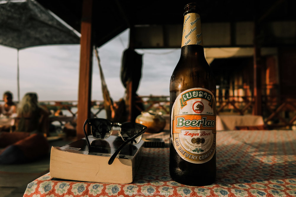 Beerlao and a good book over sunset in Don Det, Laos