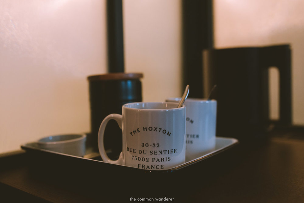 Beautifully designed mugs with the Hoxton Paris printed on them in the tea section of the interior. - THECOMMONWANDERER.COM