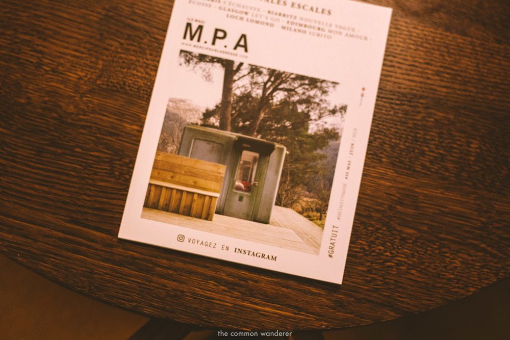 A creative magazine rests on the coffee table - THECOMMONWANDERER.COM