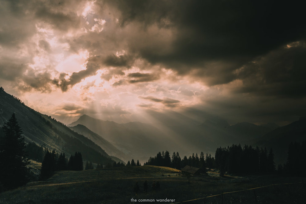Beams of light through the clouds in Bregenzerwald, Austria