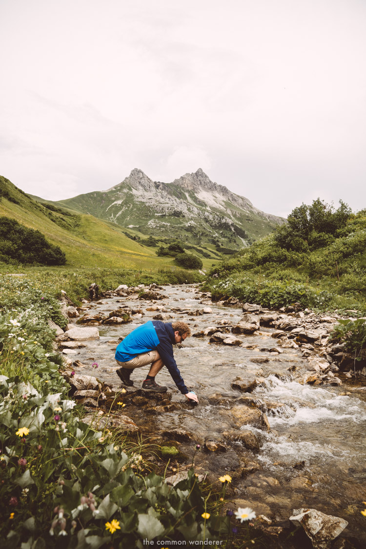 Filling up a water to go bottle in one of the mountain streams in Austria