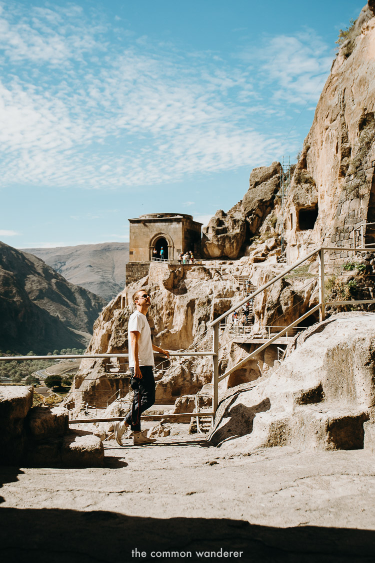 A man stands at Vardzia caves in Georgia