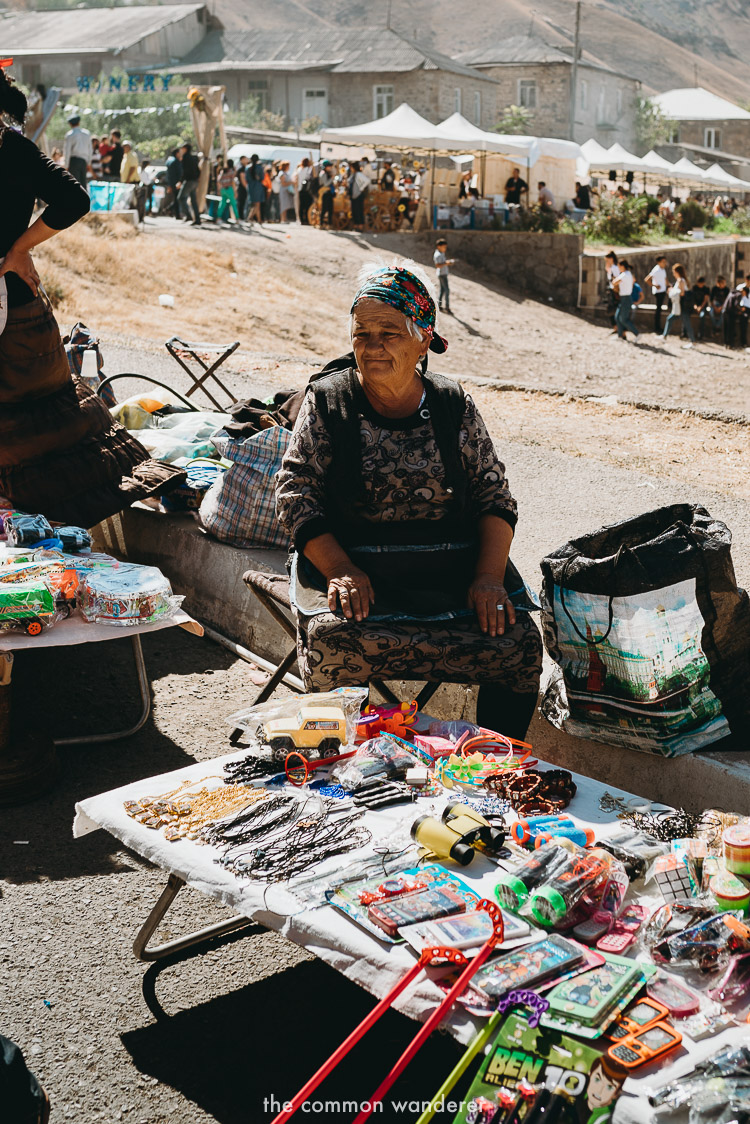 A woman selling wares at a market in Areni, Armenia