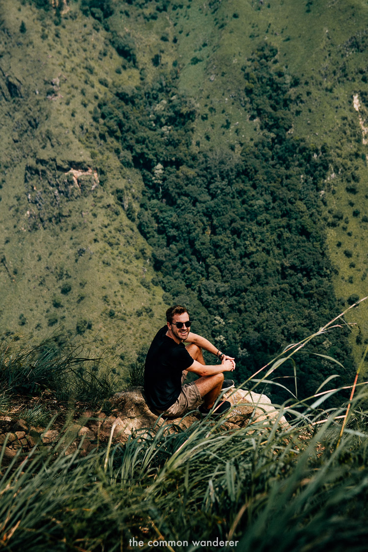 Sitting on the edge of Ella Rock in Ella, Sri Lanka
