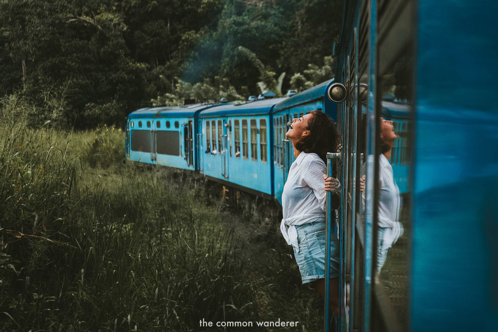 A woman riding the Kandy to Ella train in Sri Lanka - Best things to do in Ella