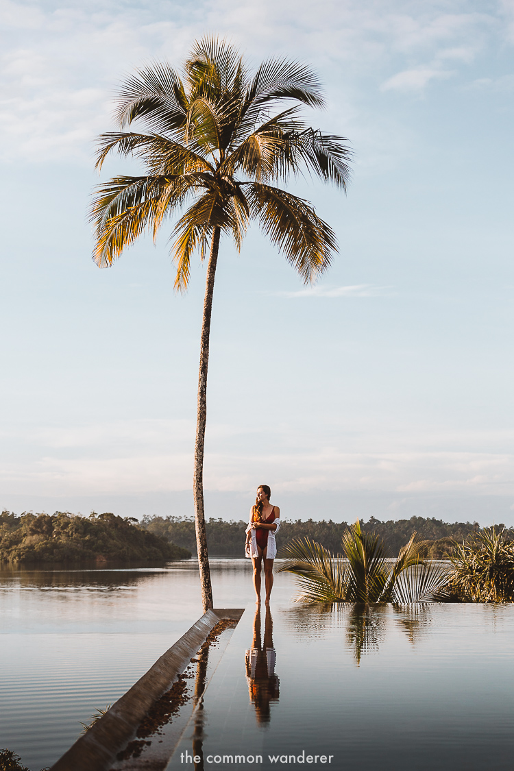 Standing on the edge of the Tri Lanka infiniti pool