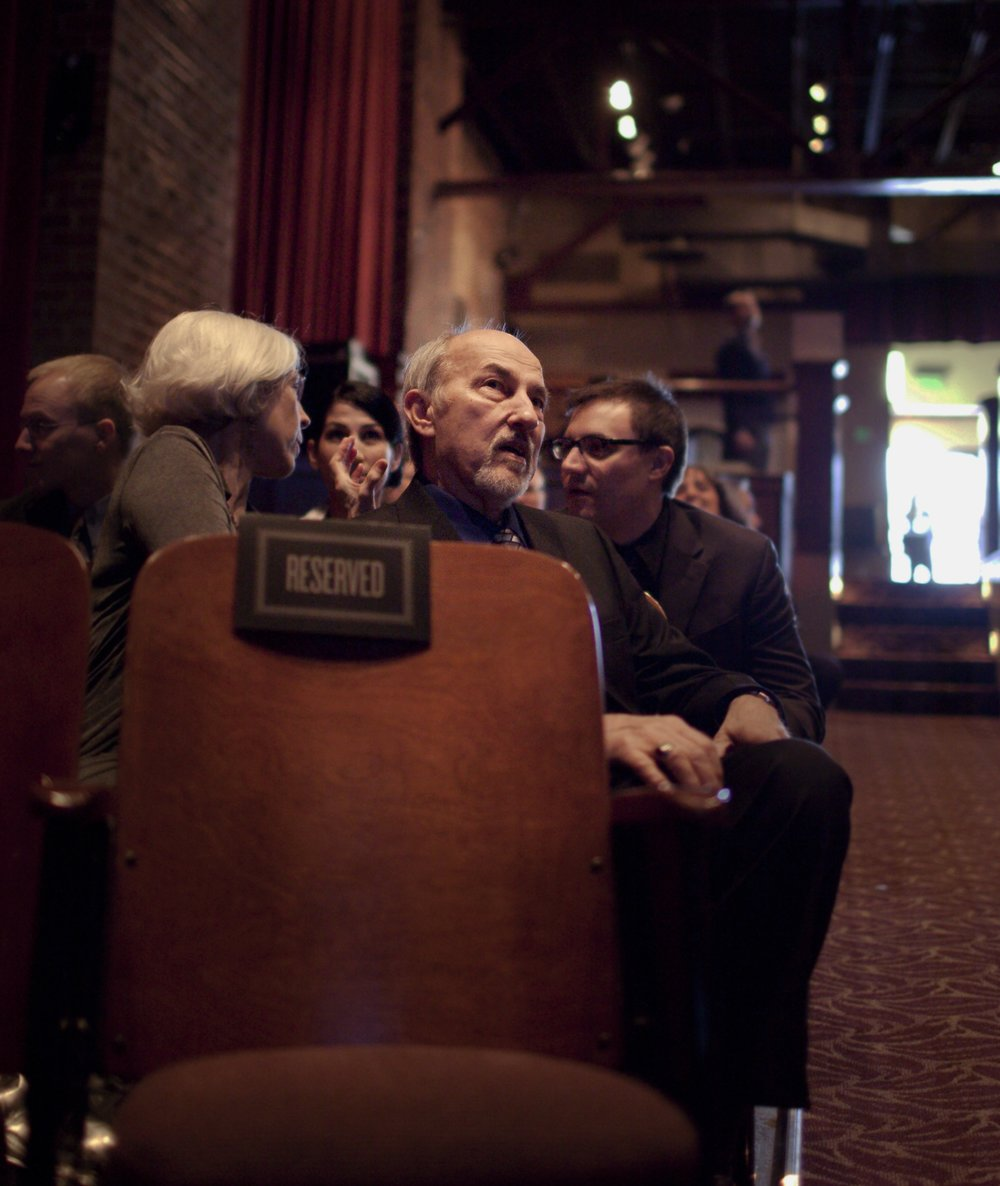 "Uncle John was enamored of all things cinema and theatre. Pictured here, intently watching Buster Keaton's ""Seven Chances"" (1925) before our wedding. Canton Theatre, Canton Georgia, 2011."