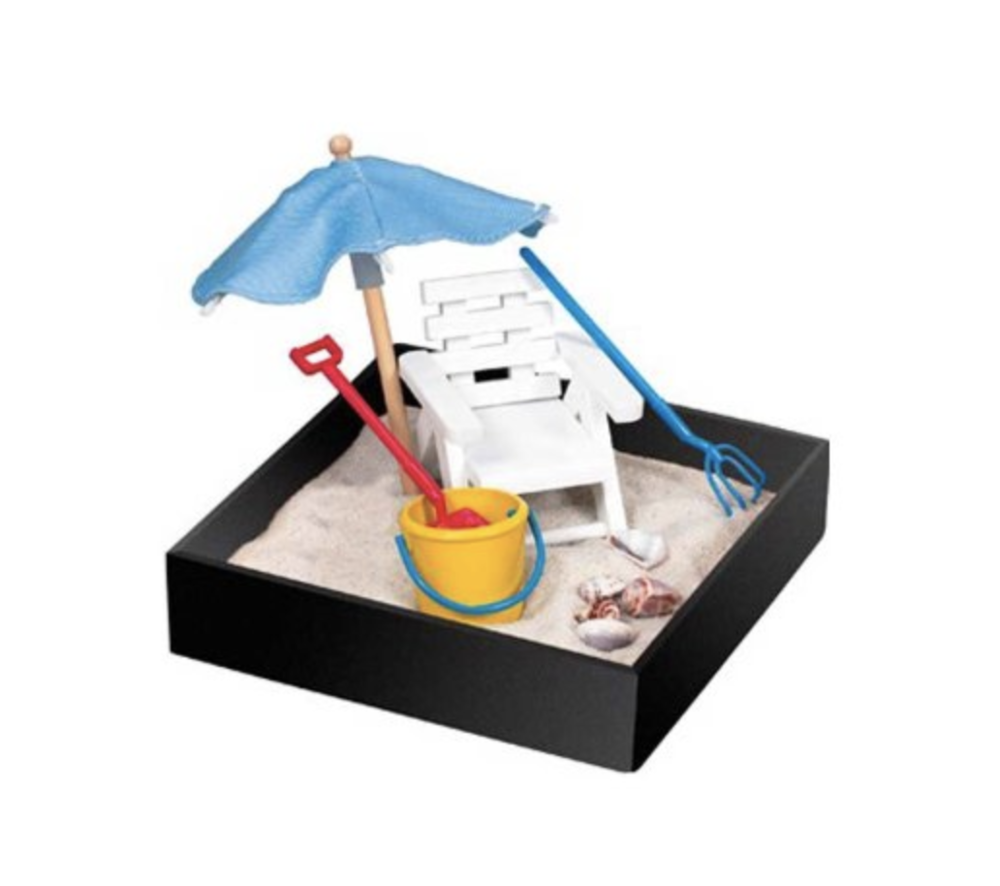 Beach Zen Garden - Sometimes you just can't make it to the beach. Serious sad face, we know. But the beach can come to you in your home or office with this pint-sized beach zen garden. Complete with a beach umbrella, chair, and sand to stick your toes, erm, fingers in, this tiny sandbox is perfect for soothing the savage beast when you can't actually make it to the beach.
