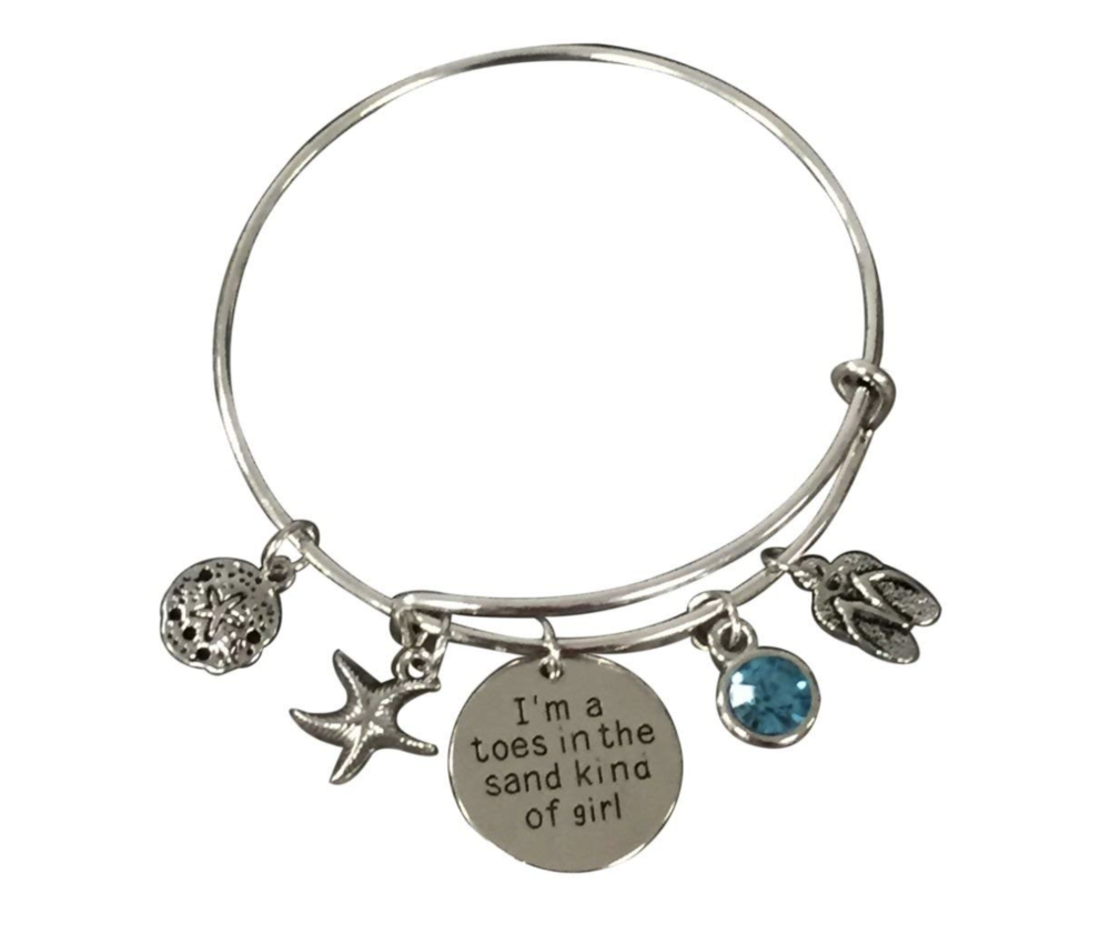 Toes in the Sand Bangle Bracelet - If you can't be at the beach, you can wear a bit of the beach with this Toes in the Sand Bangle Bracelet. This adjustable silver-plated bangle bracelet features flip-flops, a starfish, and other beach-themed charms to remind you of your favorite place.