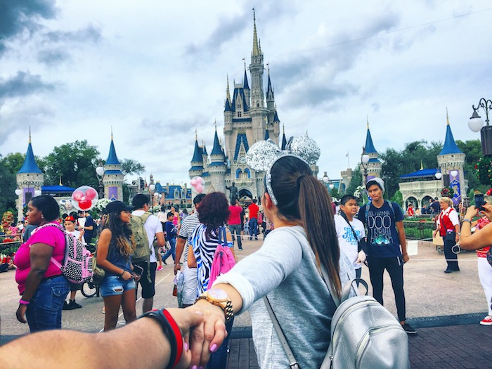 Holding Hands Looking at Disneyworldtwenty20_7ebed9f5-a9d6-4337-a9d8-7ac5a575d4c7.jpg
