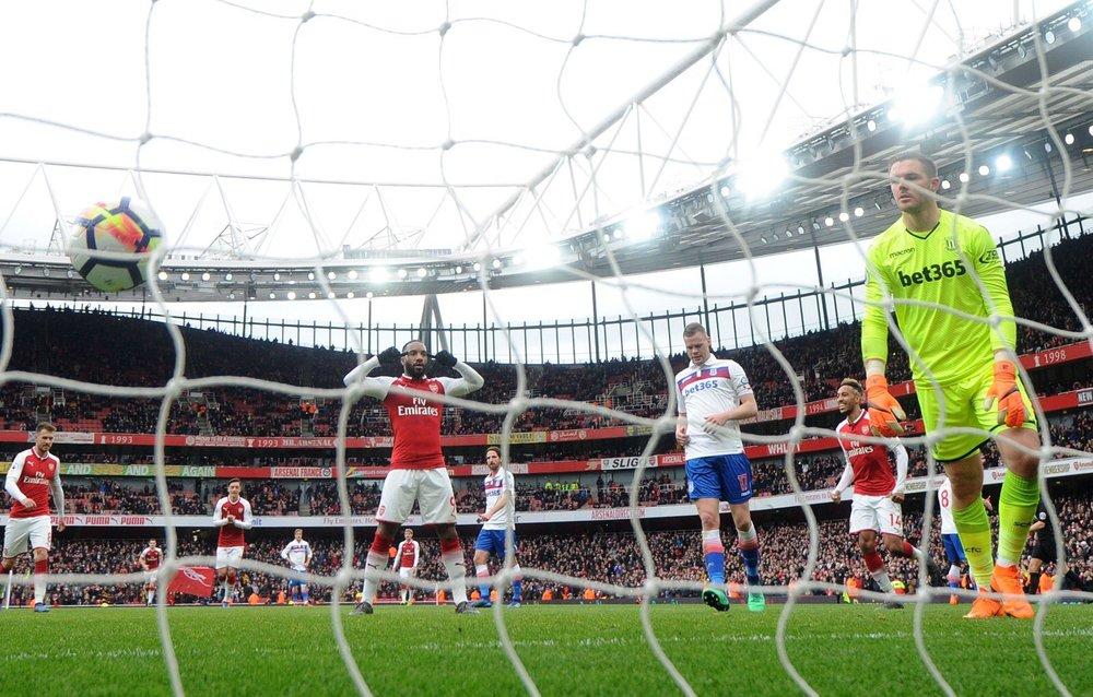 Alexander Lacazette scores a goal for Arsenal in the English Premier League against Stoke City