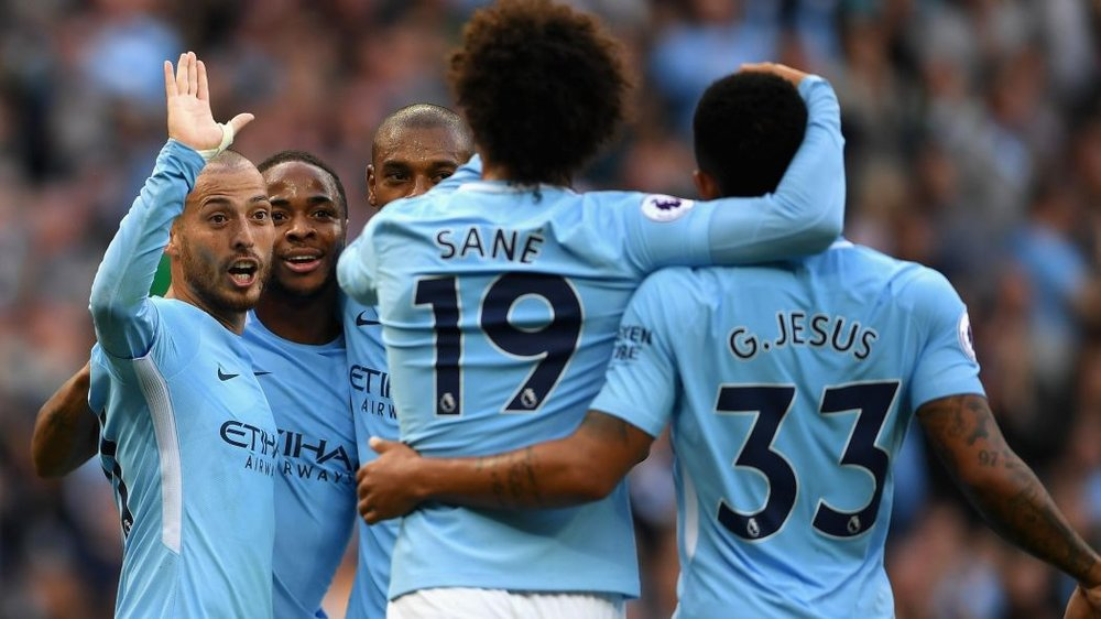 Manchester City players Leroy Sane, David Silva, Gabriel Jesus, and Raheem Sterling celebrate a goal in the English Premier League