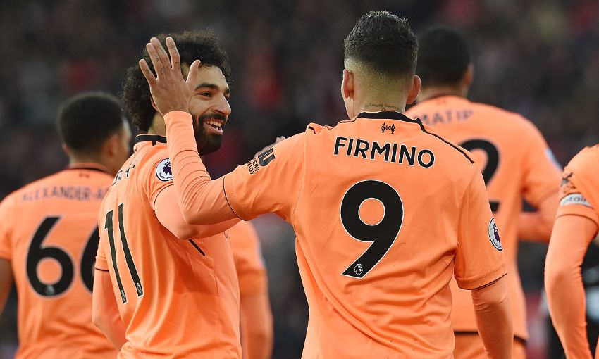 Mohamed Salah and Roberto Firmino celebrate a goal for Liverpool FC in the English Premier League