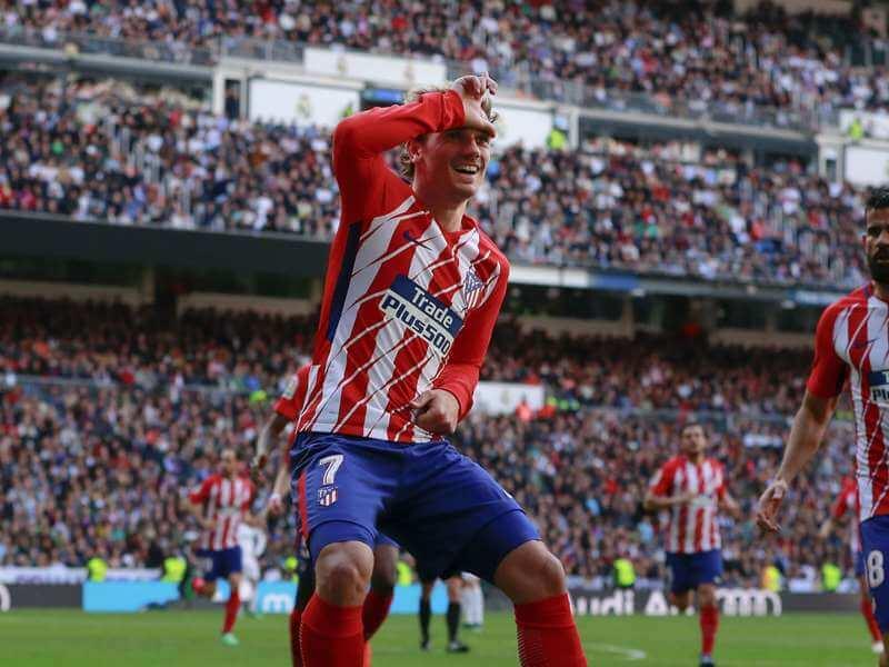 Antoine Griezmann scores a goal for Atletico Madrid against Real Madrid in La Liga Madrid Derby