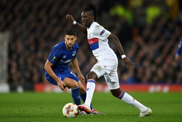 Olympique Lyon forward Bertrand Traore dribbles past defender in Ligue 1