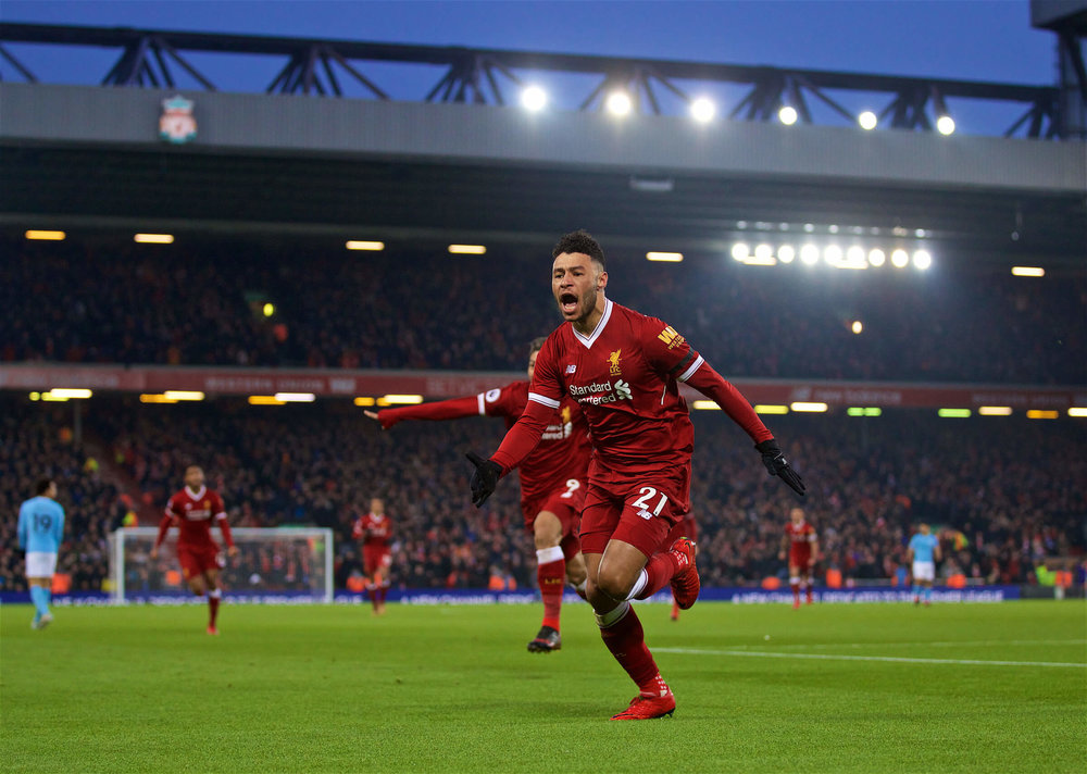 Liverpool midfielder Oxlade Chamberlain celebrates a goal against Manchester City in the UEFA Champions League