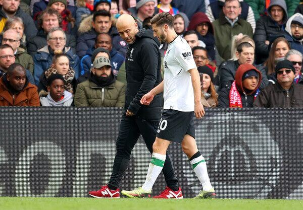 Adam Lallana walks off Anfield after sustaining injury in the English Premier League