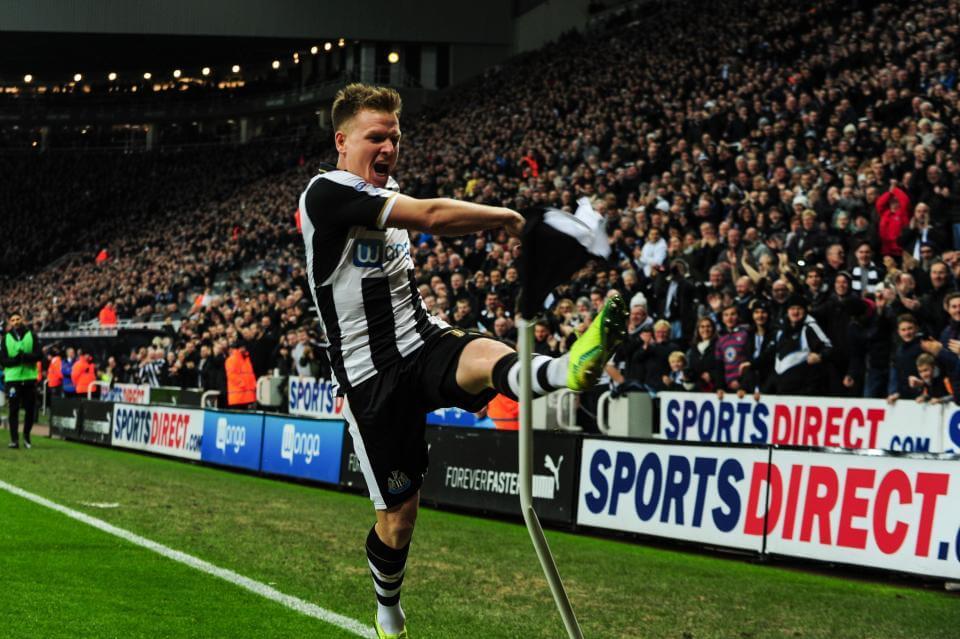 Newcastle midfielder Matt Ritchie scores a goal against Arsenal in the English Premier League