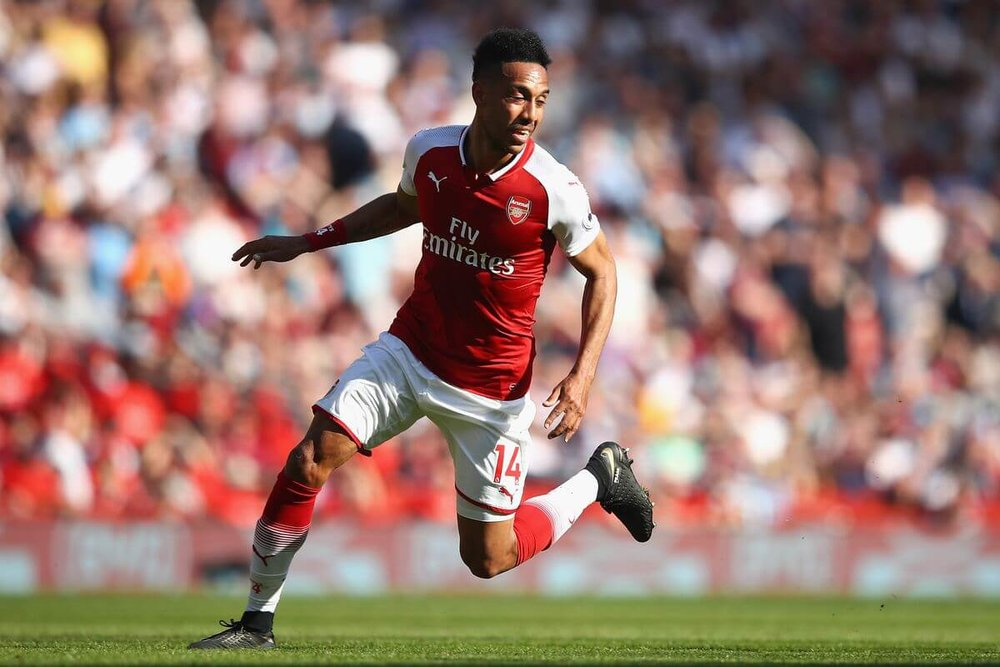 Pierre-Emerick Aubameyang of Arsenal celebrates after scoring his sides first goal during the Premier League match between Arsenal and Burnley at Emirates Stadium on May 6, 2018 in London, England.