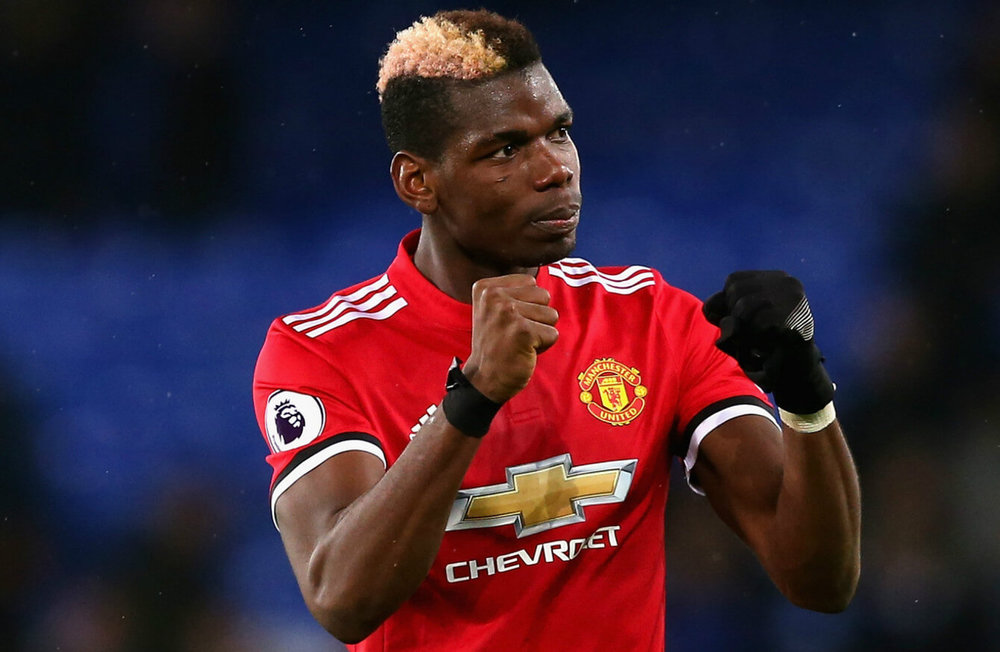 """Paul Pogba of Manchester United celebrates scoring the first goal during the Quarter Final Second Leg match between Manchester United and Manchester City at Old trafford on April 10, 2018 in Manchester, England.  """" Laurence Griffiths/Getty Images Europe"""""""
