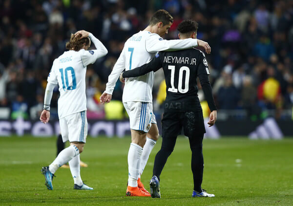 Cristiano Ronaldo of Real Madrid and Neymar of PSG embrace at half time during the UEFA Champions League Round of 16 First Leg match between Real Madrid and Paris Saint-Germain at Bernabeu on February 14, 2018 in Madrid, Spain.  (Feb. 13, 2018 - Source: Gonzalo Arroyo Moreno/Getty Images Europe)