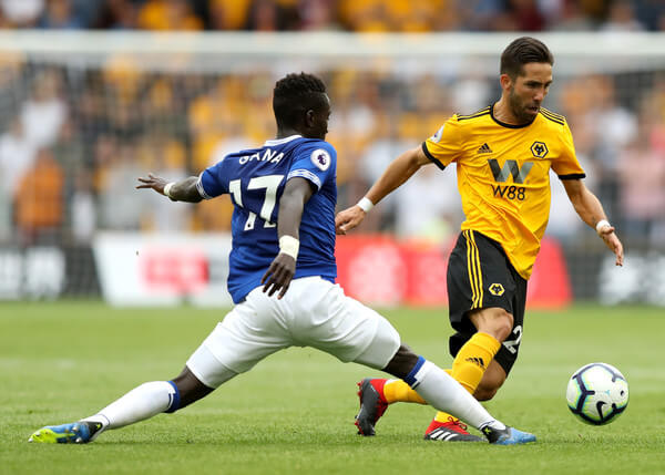 Idrissa Gueye of Everton tackles Joao Moutinho of Wolverhampton Wanderers during the Premier League match between Wolverhampton Wanderers and Everton FC at Molineux on August 11, 2018 in Wolverhampton, United Kingdom.    (Aug. 10, 2018 - Source: David Rogers/Getty Images Europe)