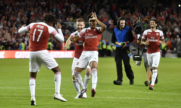Arsenal players celebrate after Alex Iwobi's winning penalty after a penalty shoot out during the Pre-season friendly International Champions Cup game between Arsenal and Chelsea at Aviva stadium on August 1, 2018 in Dublin, Ireland.    (July 31, 2018 - Source: Charles McQuillan/Getty Images Europe)