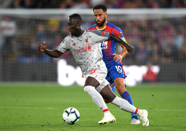 Naby Keita of Liverpool is closed down by Andros Townsend of Crystal Palace during the Premier League match between Crystal Palace and Liverpool FC at Selhurst Park on August 20, 2018 in London, United Kingdom.  (Aug. 19, 2018 - Source: Mike Hewitt/Getty Images Europe)