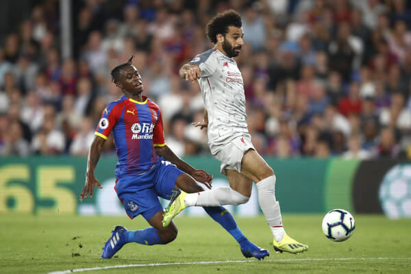 Mohamed Salah of Liverpool is fouled by Aaron Wan-Bissaka of Crystal Palace leading to a red card during the Premier League match between Crystal Palace and Liverpool FC at Selhurst Park on August 20, 2018 in London, United Kingdom.  (Aug. 19, 2018 - Source: Julian Finney/Getty Images Europe)