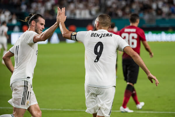 Karim Benzema #9 of Real Madrid celebrates with Gareth Bale #11 after scoring a goal during the first half of the International Champions Cup match against Manchester United at Hard Rock Stadium on July 31, 2018 in Miami, Florida.  (July 31, 2018 - Source: Rob Foldy/Getty Images North America)