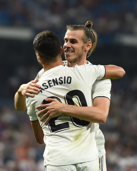 Gareth Bale of Real Madrid celebrates with Marco Asensio after scoring his teams second goal during the La Liga match between Real Madrid CF and Getafe CF at Estadio Santiago Bernabeu on August 19, 2018 in Madrid, Spain.  (Aug. 18, 2018 - Source: Denis Doyle/Getty Images Europe)