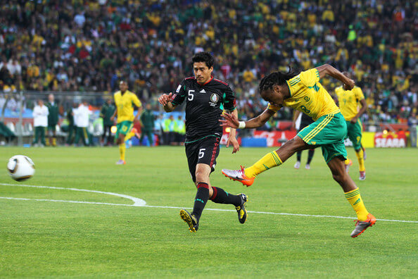 Siphiwe Tshabalala of South Africa scores the first goal during the 2010 FIFA World Cup South Africa Group A match between South Africa and Mexico at Soccer City Stadium on June 11, 2010 in Johannesburg, South Africa.  (June 10, 2010 - Source: Clive Rose/Getty Images Europe)