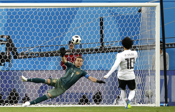 Mohamed Salah of Egypt scores his team's first goal from the penalty spot past Igor Akinfeev of Russia during the 2018 FIFA World Cup Russia group A match between Russia and Egypt at Saint Petersburg Stadium on June 19, 2018 in Saint Petersburg, Russia.  (June 18, 2018 - Source: Julian Finney/Getty Images Europe)