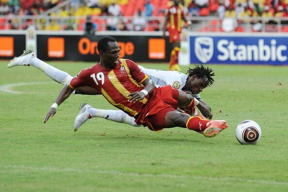 Emmanuel Agyemang-Badu (front) of Ghana and Jonathan Pitroipa of Burkina Fuso compete during the Africa Cup of Nations Group B match between Burkina Fuso and Ghana, from the November 11 Stadium on January 19, 2010 in Luanda, Angola.  (Jan. 18, 2010 - Source: Gallo Images/Getty Images Europe)